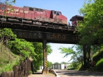 090524049 Eastbound CP freight crosses ex-SOO Line bridge over Maple Street