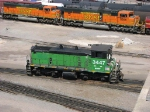 090530018 ex-GN BNSF 3447 is busy at the Northtown diesel shop as stored SD75M units slumber