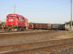 090530095 CP inspection train led by GP38 #3013 lays over across from roundhouse at Pigs Eye Yard
