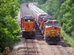 090614006 Westbound DEEX coal empties on main meet eastbound BNSF manifest in siding on Wayzata Sub.