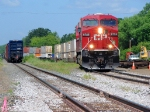 090726011 Westbound CP freight on mainline meets eastbound stack train in siding