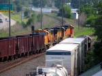 090803039 Eastbound BNSF SEMBIR taconite loads pass the CP Scrap Job at CTC Newport Jct.