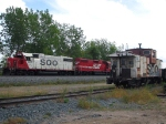 090920006 Westbound CP freight with SOO power waits for meet in passing siding