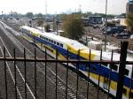 091013122 Eastbound Northstar MNRX commuter train passes BNSF Northtown Yard
