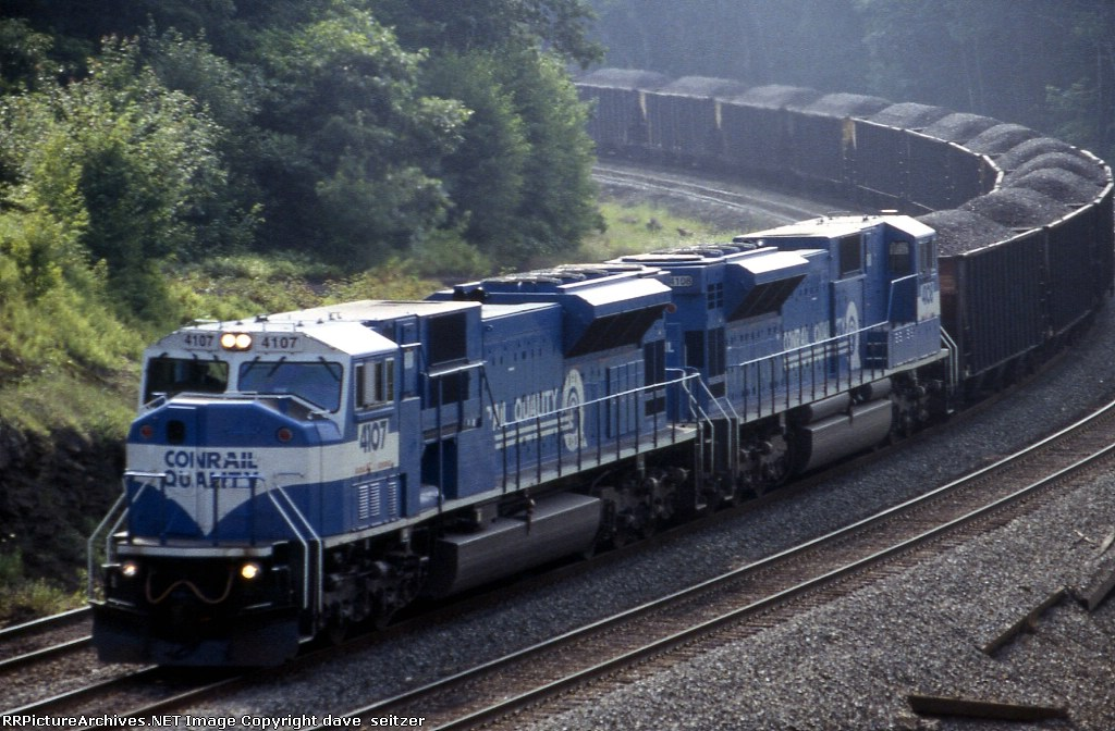 Consecutively numbered SD80MACs lead a heavy coal train near Route 352 in Cresson,PA