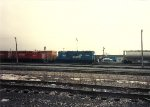 A GP10 switches box cars while CP GP9u's await there next assignment