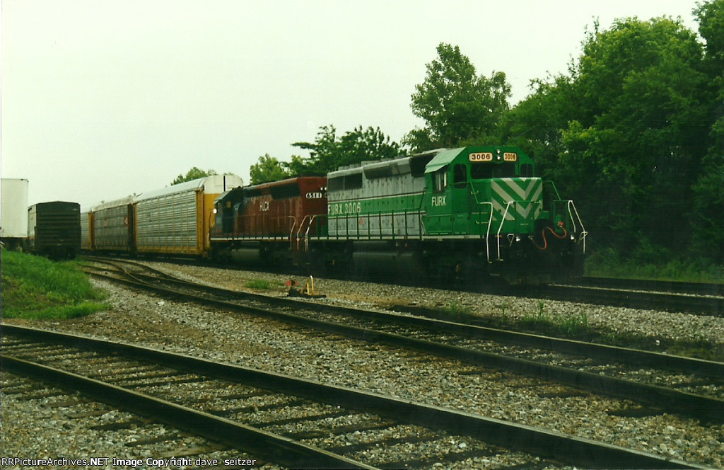 A pair of lease units tied down on a Westbound train