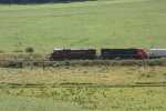 MEHN heads East with a pair of big 6 axle ALCO/MLWs