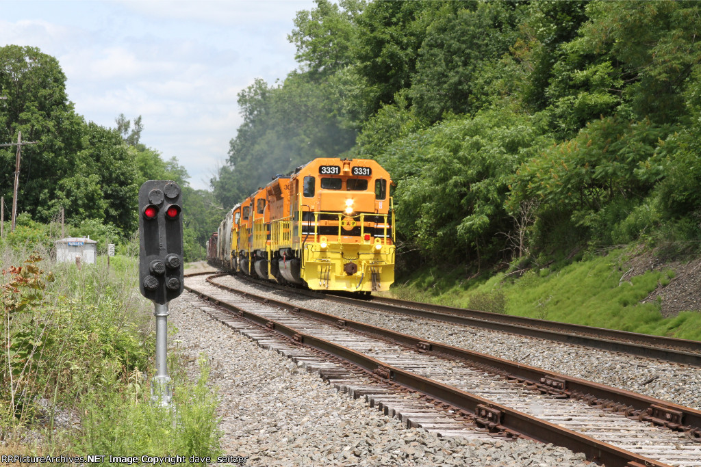 Four Six axle EMD's head South passed the  Dwarf signal at Wales. The leader is a recently aquired SD40-3 that has been freshly repainted.