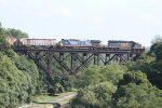 Loaded grain train G070 passes over the upside down bridge headed East to Shelby, NY.