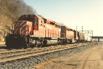Westbound grain train exits yard to head uphill
