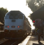 Metrolink engine #902 under the setting sun