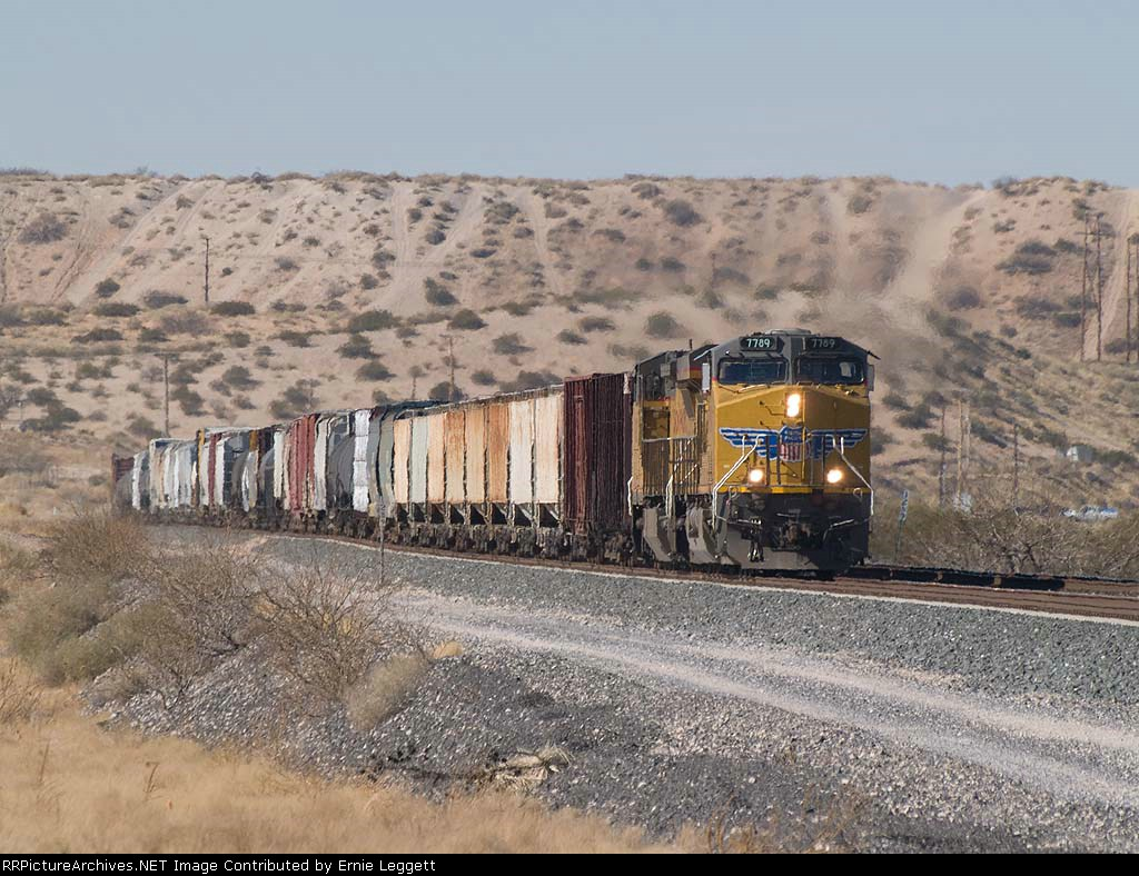 UP 7789 leads an EB manifest MWCDA-18 at 12:58pm