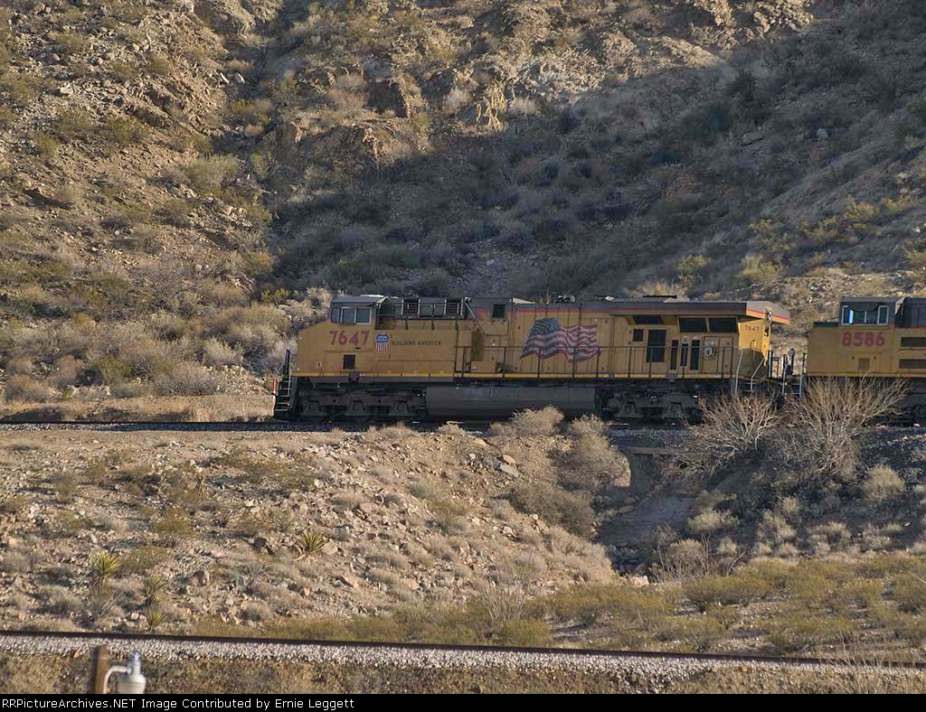 UP 7647 leads an EB work train WCOSBB-18 at 3:23pm