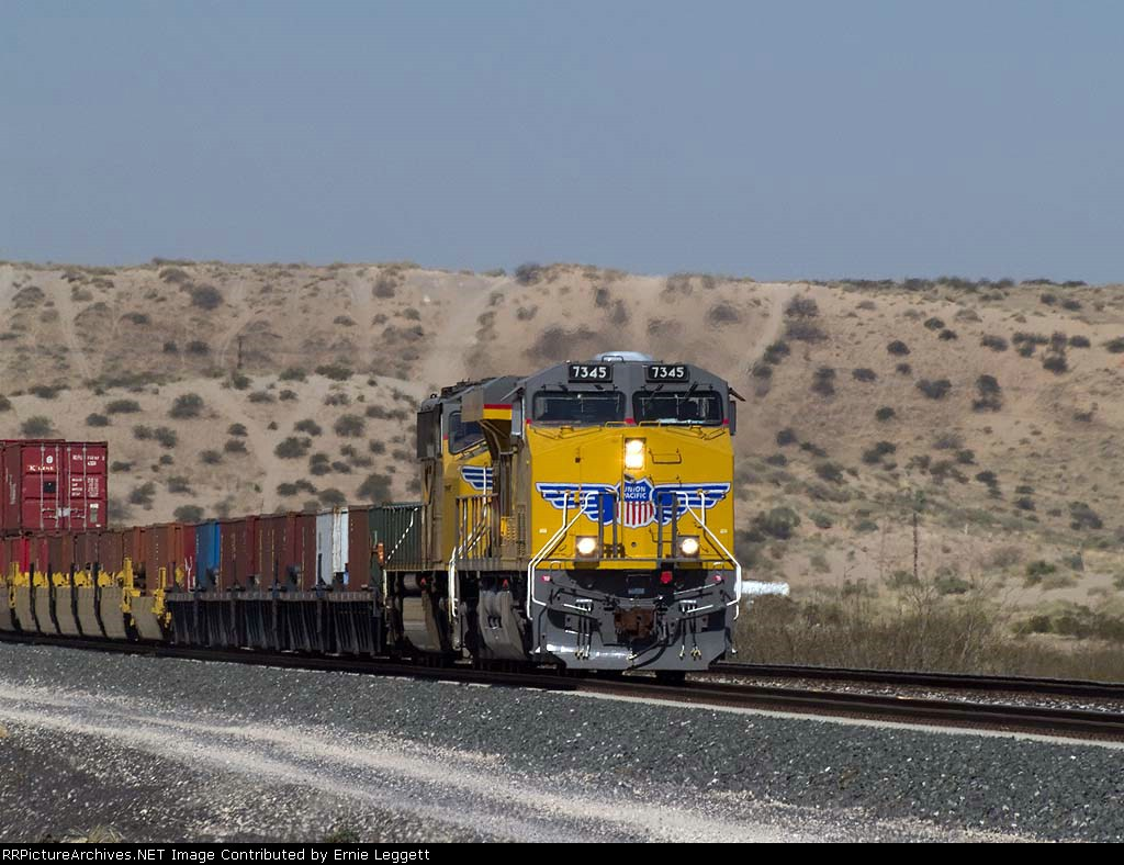UP 7345 leads an EB doublestack at 10:58am