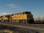 UP 7775 leads an EB doublestack ILADU-18 at 4:21pm