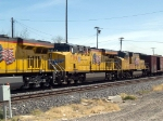 UP 7799 #2 power in a WB manifest (MFWWC) at 1:01pm