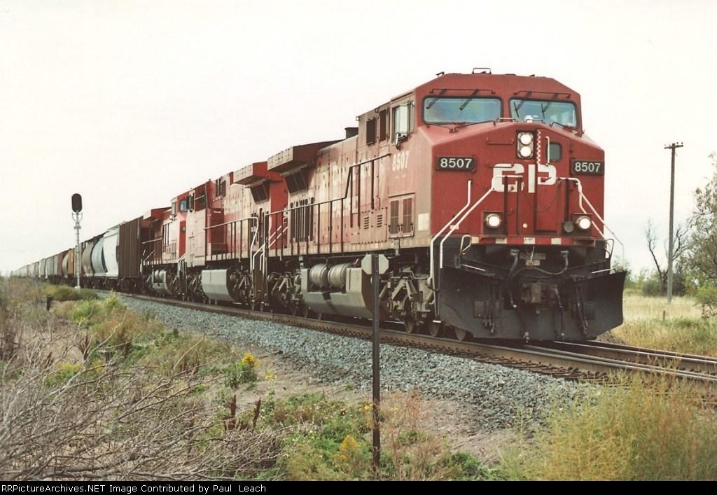 Eastbound grain train approaches BNSF crossing