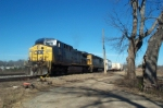 CSX 123 on A746 rattles the woodyard switch as it shoves Kia supplier high wide loads into the spur