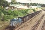 Empty coke train climbs uphill