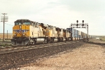 Westbound stack train cruises through junction