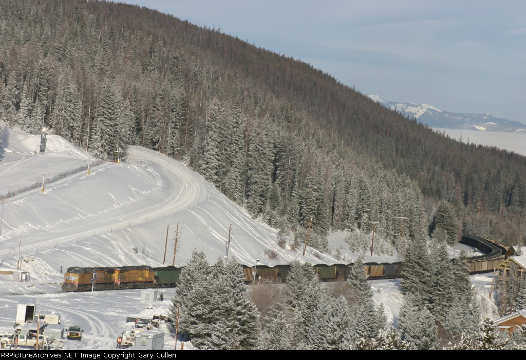UP Loaded Coal Train approaches Winter Park Ski Area as a train full of westbound emptys sits on track #2