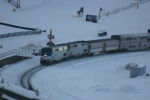 Amtrak #6 passing the Winter Park Ski Resort after dusk