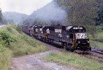 Classic power pulling an empty coal train