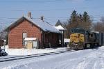 Q231 passes the depot.