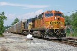 BNSF power leads a CSX rack train