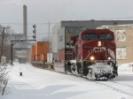 CP 8519 digs in as it leads X500-12 east on a cold windy January day