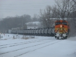 With a long cut of empty ethanol tanks in tow, Q381-11 rolls into the yard