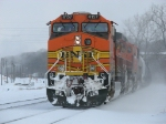 Rerouted due to a derailment, BNSF 4157 leads Q381-11 through the snow