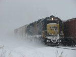 Shrouded by falling and blowing snow, CSX 8577 leads Q335-29 west