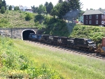A NS train smokes up into the Allegany tunnel after performing a brake test