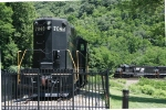 NS 6304 leads a WB helper set past the old PRR GP9 on display at the horseshoe curve