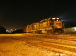 CSX 6458 along with a GP30 Slug rest on New Years with an empty rail train in tow