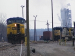 CSX 390 (power for F783) backs up towards its train while power for Q461 (CSX 7515) sit near the Yard tower