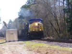 CSX 21 leads an empty rock train off the siding