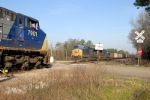 Q210 on tghe siding and passing the loaded coal train