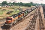 Westbound diesel fuel train rolls through University