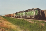 Westbound loads pass empties in siding