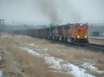 BNSF 8240 hauling coal drag up grade on snowy day