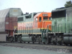 BNSF 2125 GP38AC in front of excess height car hauling Boeings