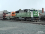BNSF 9233 SD60M and BNSF 2125 GP38AC waiting for eastbound to pass
