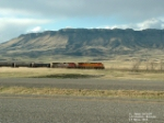 BNSF 672 leading tanker cars below Sheep Mountain
