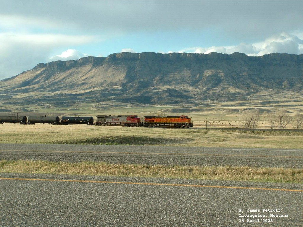 BNSF 672 leading tanker cars below Sheep Mountain