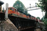 BNSF 7010 follows UP 7275 across this bridge