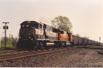 Westbound empty coal train pounds the diamond