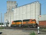 BNSF SD40-2's lead a westbound stack train